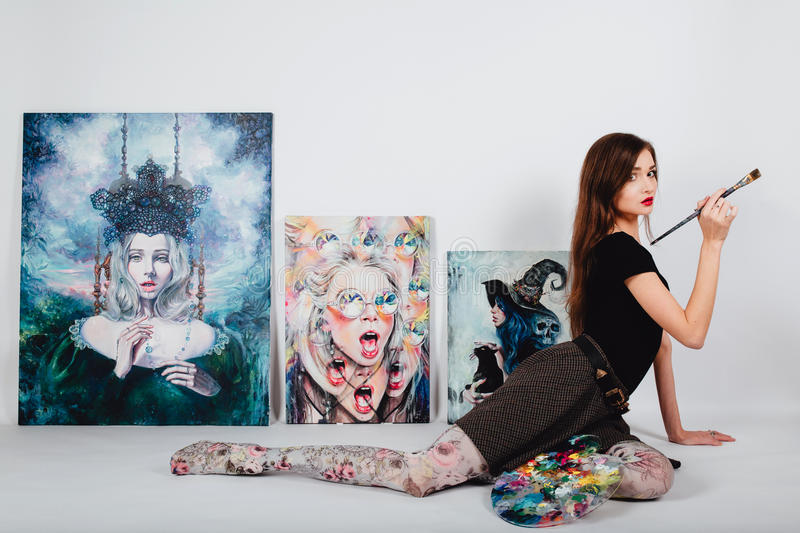 Female artist at Picture canvas on white background. Girl painter with brushes and palette. Art creation concept. Beautiful female artist at Picture canvas on stock photo