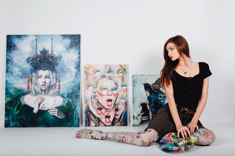 Female artist at Picture canvas on white background. Girl painter with brushes and palette. Art creation concept. Beautiful female artist at Picture canvas on stock photos