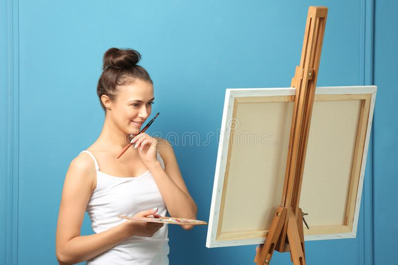 Female artist waiting for inspiration on color background stock photos