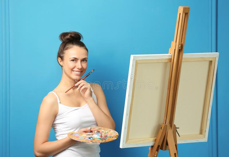 Female artist waiting for inspiration on color background stock photo