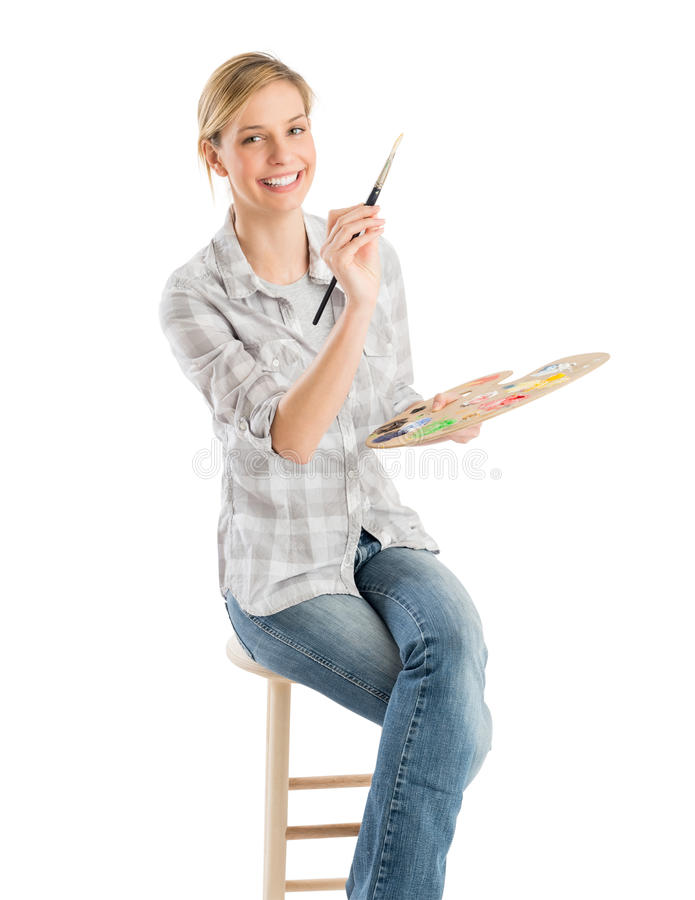 Free Female Artist With Paintbrush And Palette Sitting On Stool Royalty Free Stock Photo - 32145775