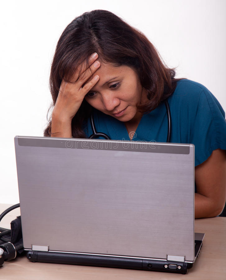 Female asian thirties medical personnel headache stock photography