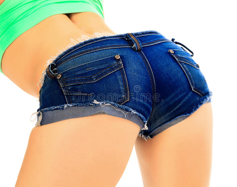 Female in blue jeans shorts royalty free stock image