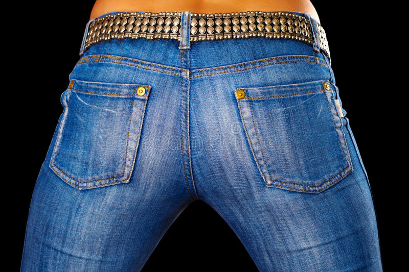 Female dressed in jeans on black royalty free stock photography