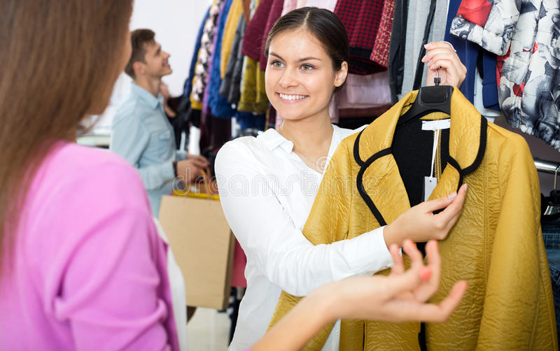 Female assistant serving happy customers stock photos
