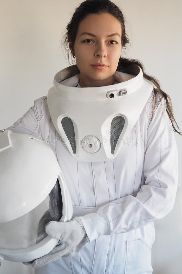 Female astronaut on a white background. Fantastic space suit. Exploration of outer space. Female astronaut on a white background. Fantastic space suit royalty free stock photo