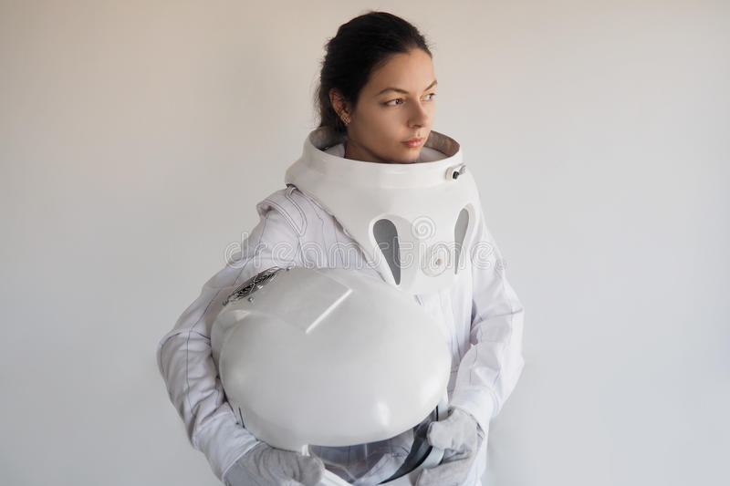 Female astronaut on a white background. Fantastic space suit. Exploration of outer space. Female astronaut on a white background. Fantastic space suit royalty free stock images