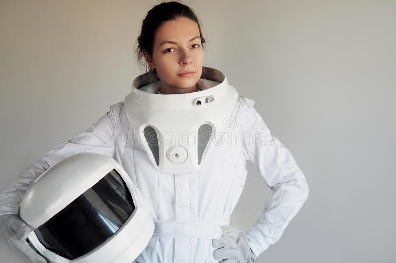 Female astronaut on a white background. Fantastic space suit. Exploration of outer space. Female astronaut on a white background. Fantastic space suit stock images