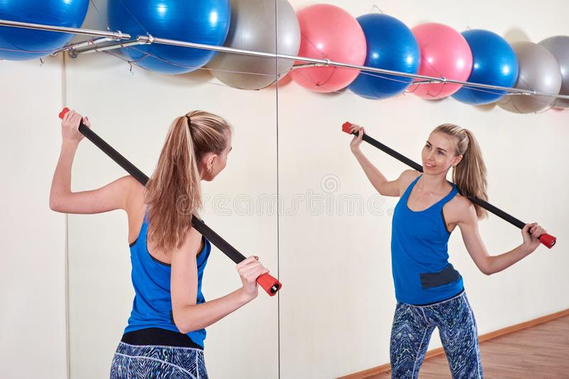 Female athlete doing sport exercise. Concept of health and body care. stock photos