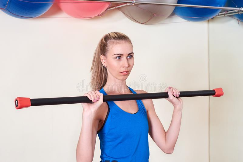 Female athlete doing sport exercise. Concept of health and body care. royalty free stock photos