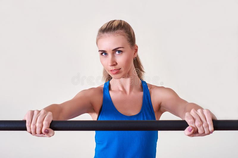 Female athlete doing sport exercise. Concept of health and body care. stock image