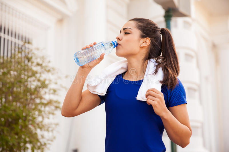 Female athlete drinking water royalty free stock images