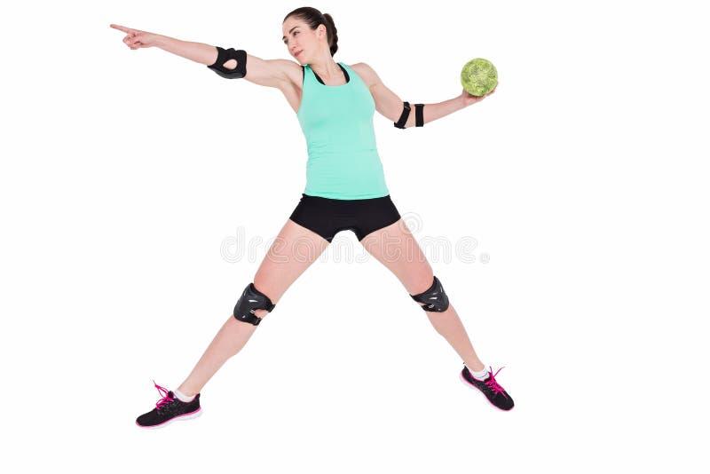 Female athlete with elbow pad throwing handball royalty free stock photo