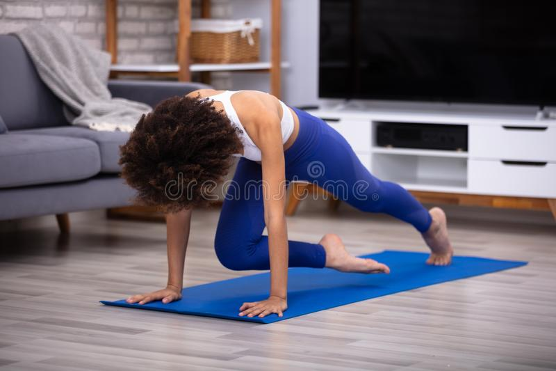 Female Athlete Exercising On Fitness Mat royalty free stock photography