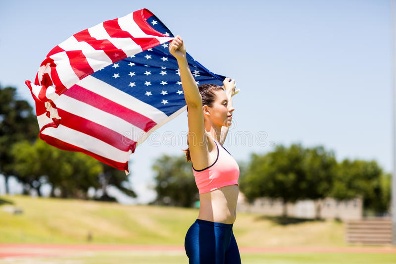Female athlete holding an american flag stock photos