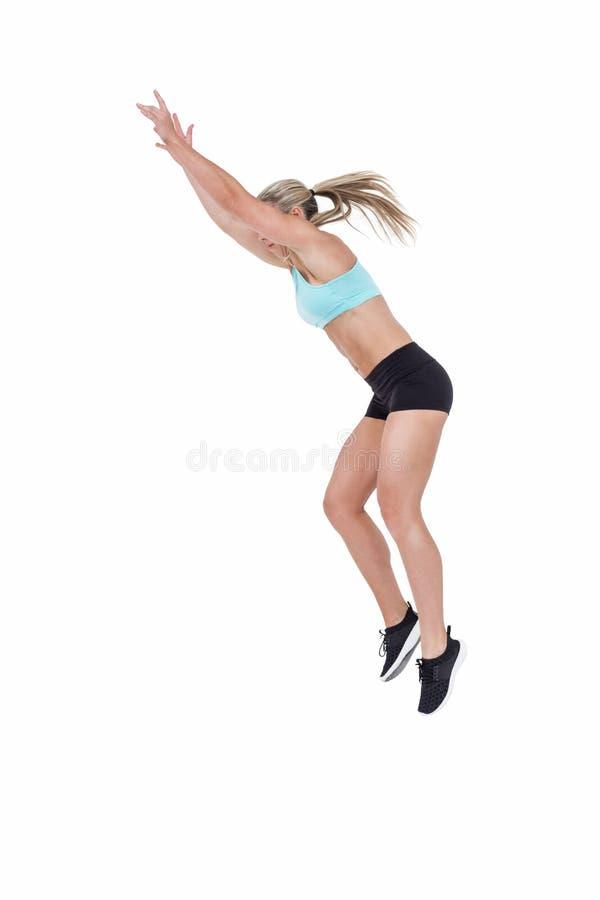 Female athlete jumping stock image