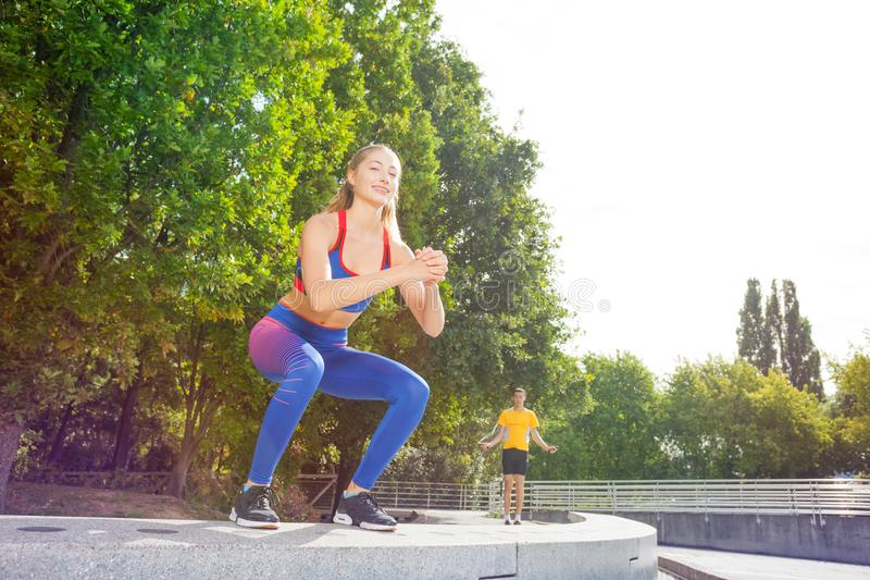 Female athlete performing jumps outdoors at park royalty free stock image