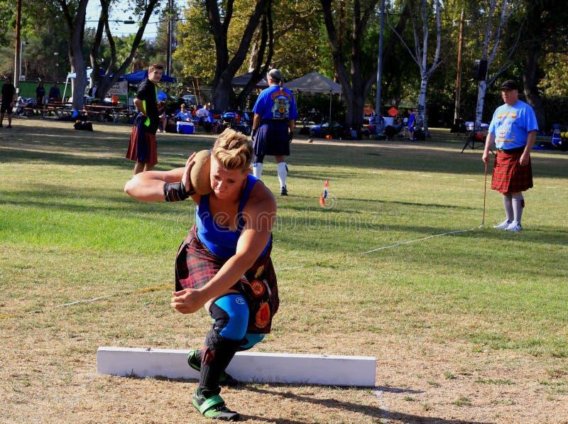 Female Athlete preparing to throw the stone stock image