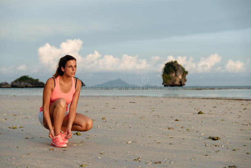 Female athlete ready for running at beach stock images