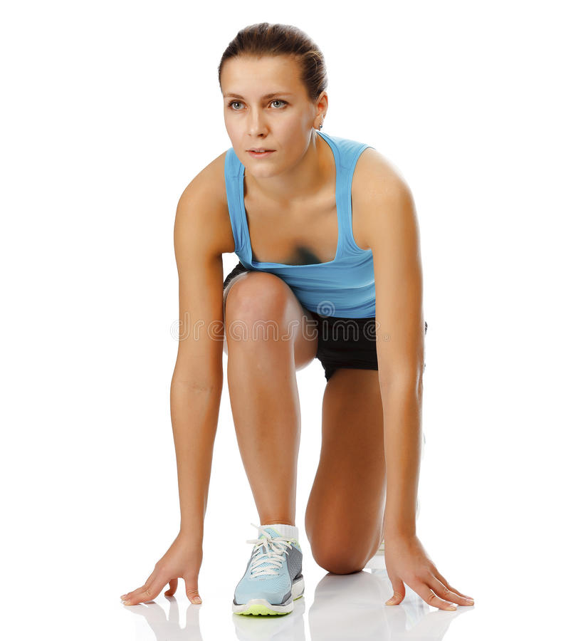 Female athlete ready to run. Isolated on a white background stock photography