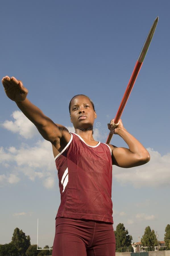 Female Athlete Ready To Throw Javelin royalty free stock photo