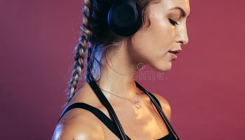 Female athlete resting after exercising royalty free stock photos