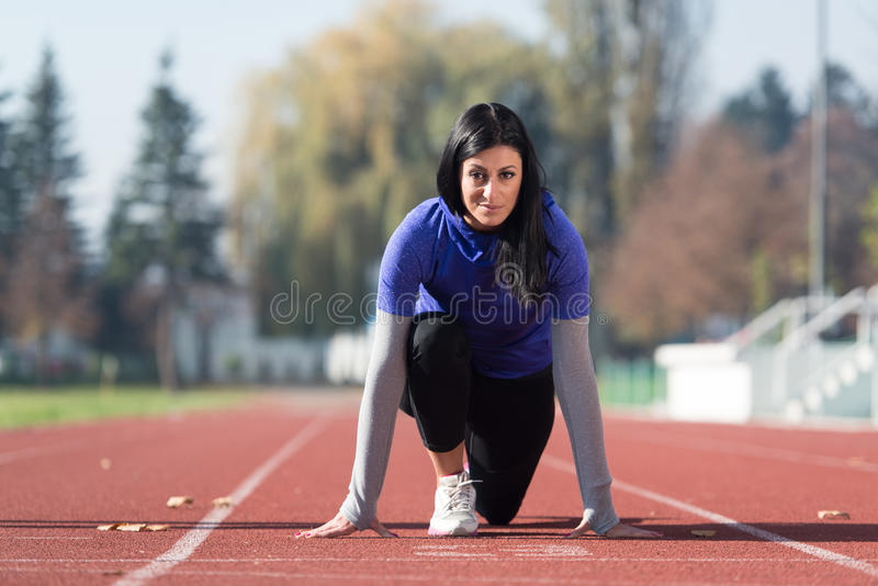 Download Female Athlete Standing In A Start Position Stock Photo
