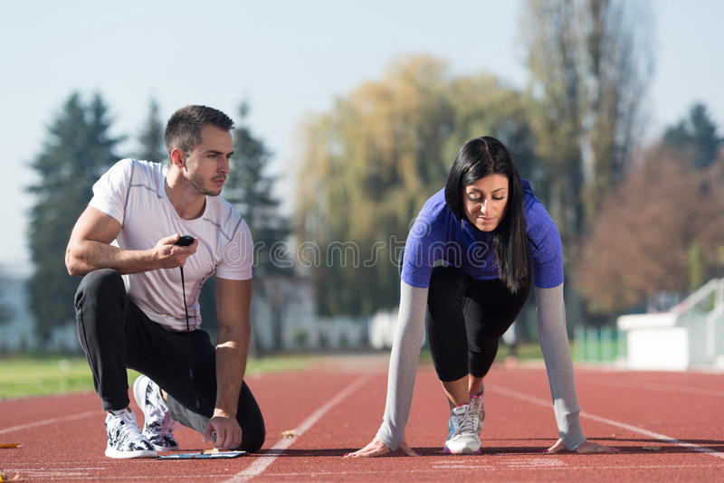 Download Female Athlete Standing In A Start Position Stock Image