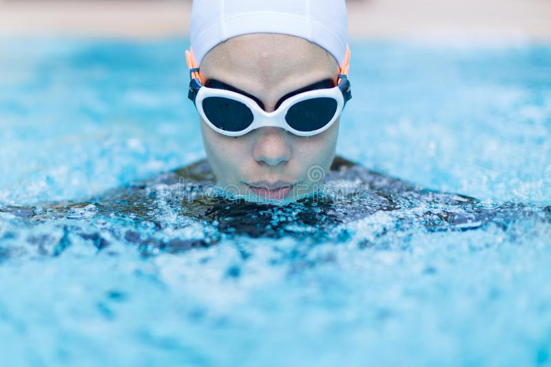 Portrait of a professional sportswoman swimmer in the water royalty free stock photography