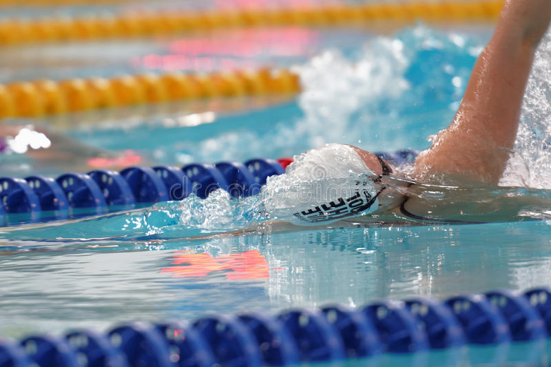Female athlete in swimming competitions royalty free stock photography