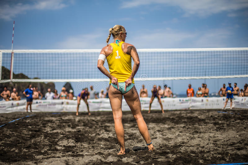 Female athletes in action during a tournament in Beach Volleyball stock image
