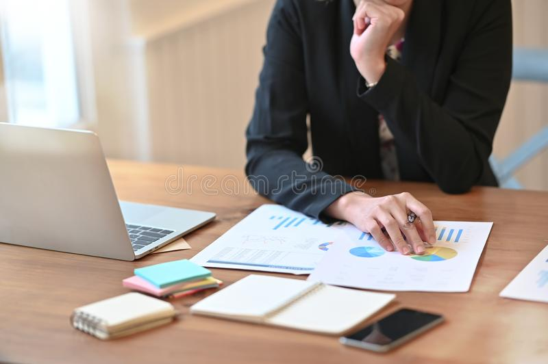 Female audit analysis finance data in paper document on working table.  royalty free stock images