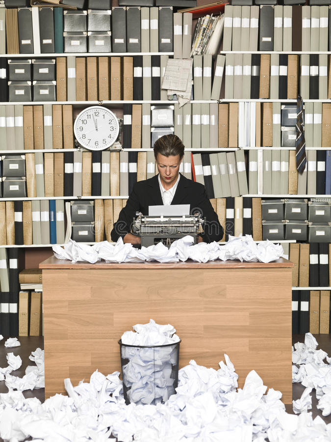 Female Author. At a messy office stock images