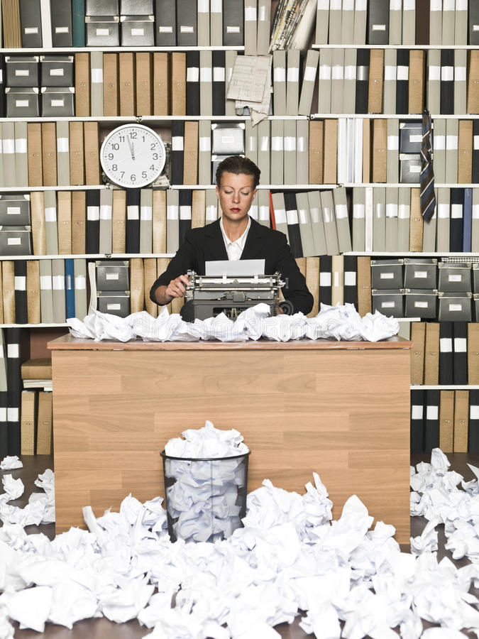 Female Author. At a messy office stock photos