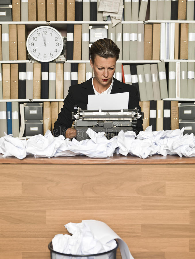 Female Author. At a messy office stock photography