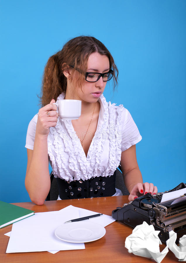 Female author with vintage. Cute female author with vintage typewriter writing something royalty free stock photos