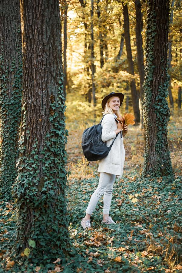 Female autumn fashion concept. Woman happy autumn. Autumn and leaf fall Dreams. Autumn time for Fashion. Portrait of. Beautiful woman walking outdoors stock photos