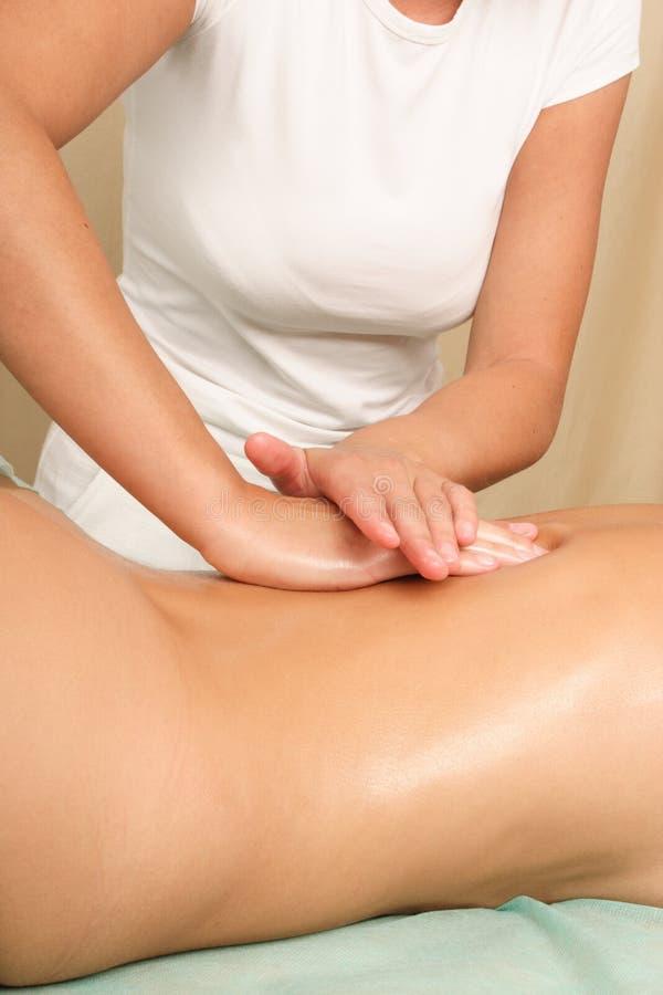 female Back massage - vertical stock photography