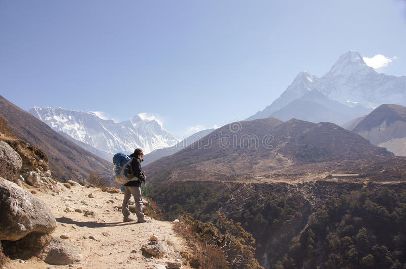 Female backpacker hikes trail royalty free stock images