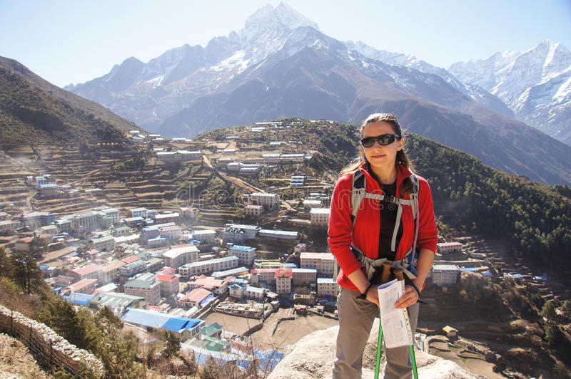 Female backpacker by Namche Bazaar stock images