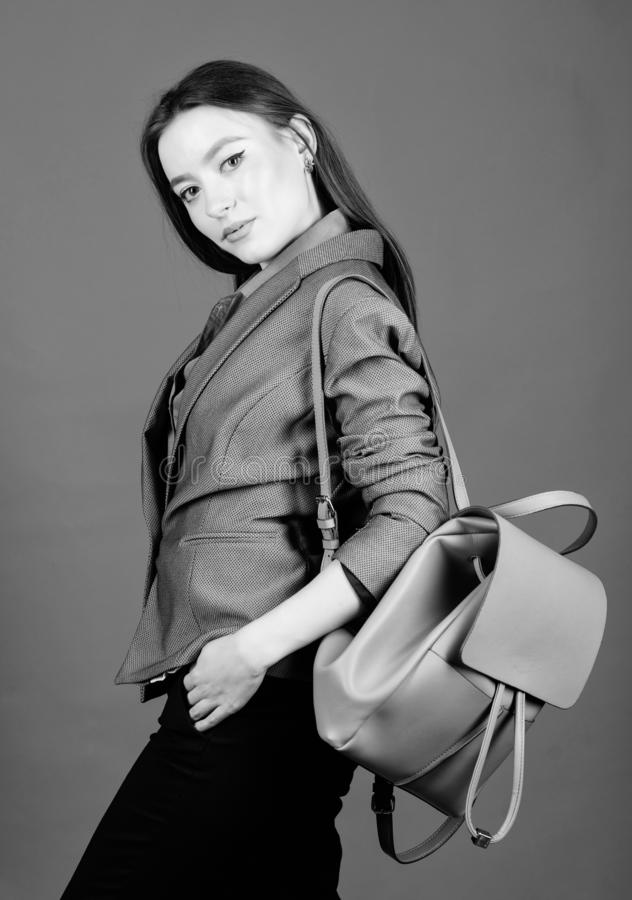 Female bag fashion. girl student in formal clothes. student life. Smart beauty. Nerd. business. Shool girl with knapsack. Stylish woman in jacket with leather royalty free stock photo