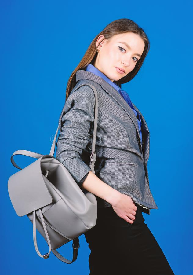 Female bag fashion. girl student in formal clothes. student life. Smart beauty. Nerd. business. Shool girl with knapsack. Stylish woman in jacket with leather stock images