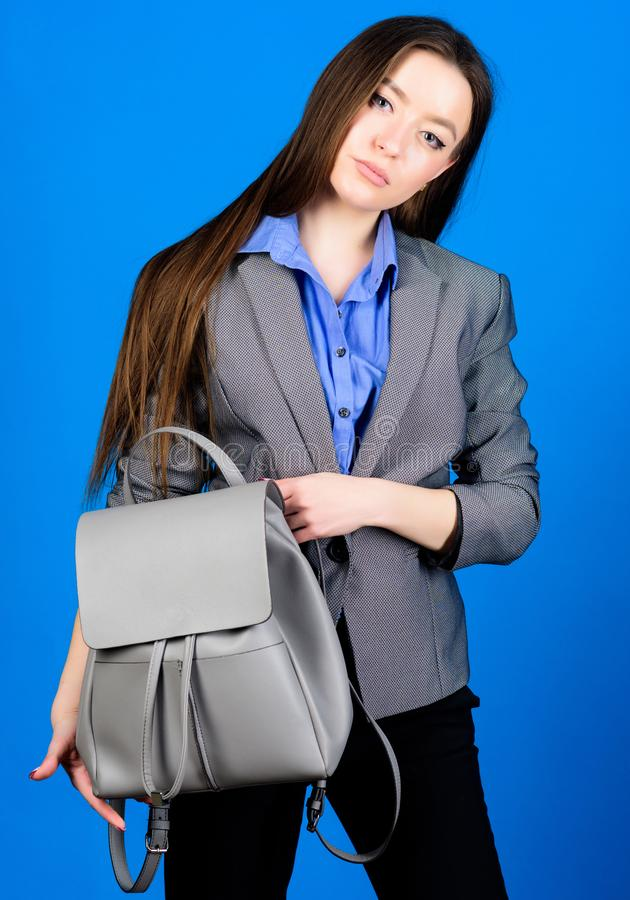 Female bag fashion. stylish woman in jacket with leather backpack. business. Shool girl with knapsack. girl student in. Formal clothes. student life. Smart stock image