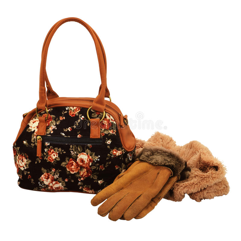Female bag, gloves and scarf. Isolated on white royalty free stock photography
