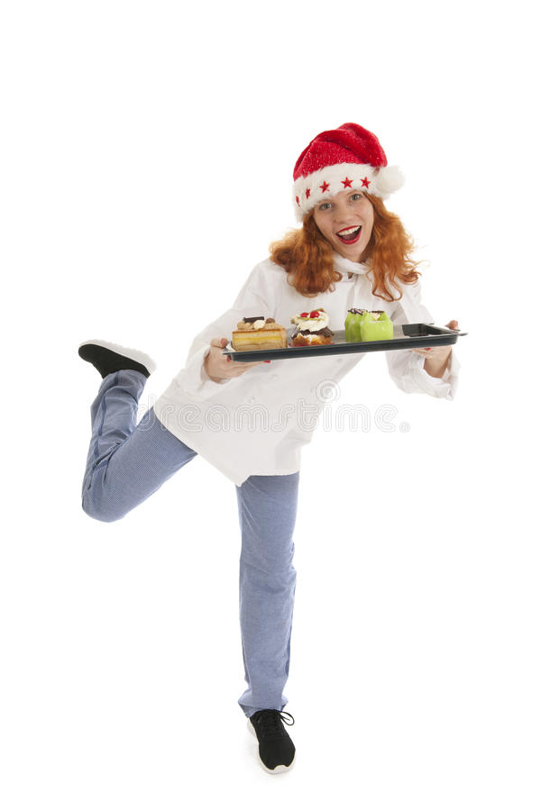 Female baker chef with hat of Santa Claus dancing with Christmas royalty free stock photo