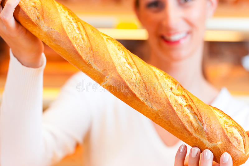 Download Female Baker In Her Bakery With Baguette Stock Image - Image: 24876165