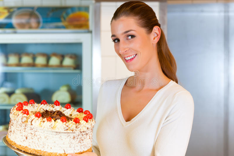 Download Female Baker Or Pastry Chef With Torte Stock Photo - Image: 23332492