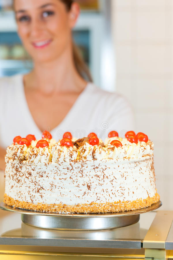 Female Baker Or Pastry Chef With Torte Stock Photos