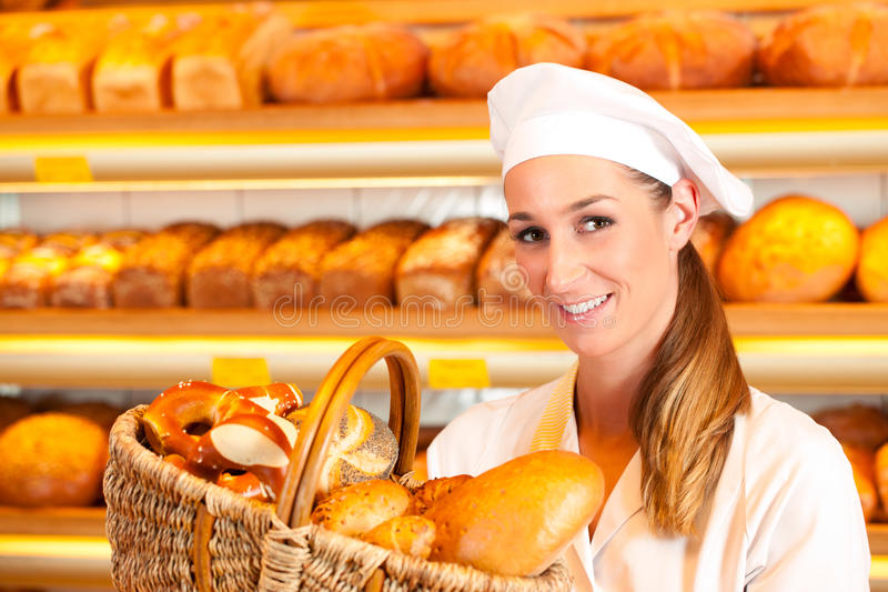 Download Female Baker Selling Bread By Basket In Bakery Stock Photo - Image: 22772864