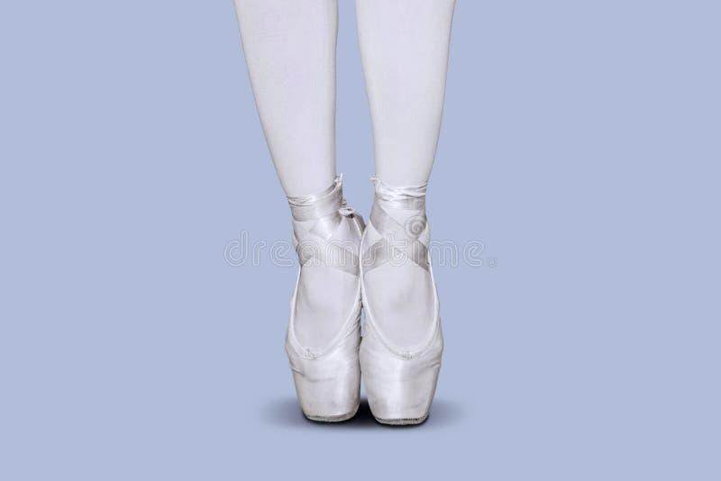 Female ballet dancer feet dancing with tiptoe pose stock image